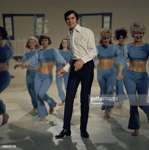 British singer Engelbert Humperdinck performs with the Peter Gordino dancers on the set of his television series 'The Engelbert Humperdinck Show' in...