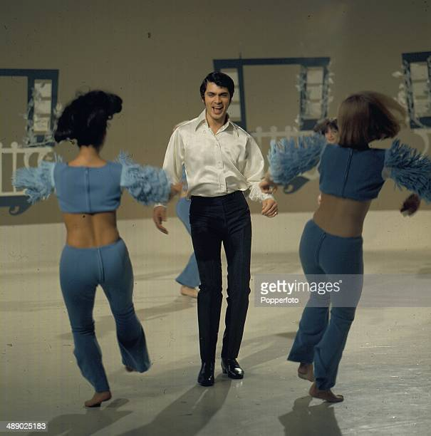 British singer Engelbert Humperdinck performs with the Peter Gordino dancers on the set of his television series 'The Engelbert Humperdinck Show' in...