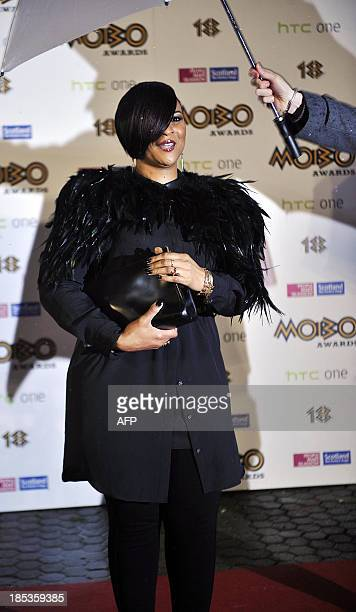 British singer Gabrielle poses for pictures as she arrives for the 2013 Mobo Awards in Glasgow Scotland on October 19 2013 AFP PHOTO / ANDY BUCHANAN