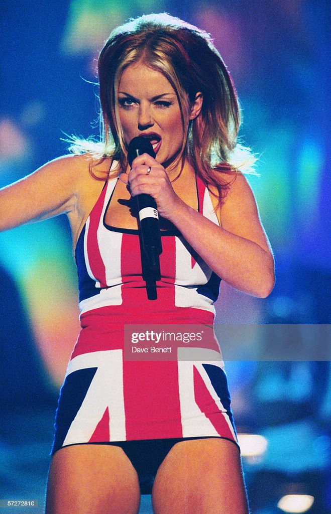 British singer Geri Halliwell, a.k.a. Ginger Spice of the Spice Girls on stage at the Brit Awards, in a union jack dress, 24th February 1997.