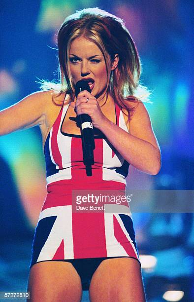 British singer Geri Halliwell aka Ginger Spice of the Spice Girls on stage at the Brit Awards in a union jack dress 24th February 1997