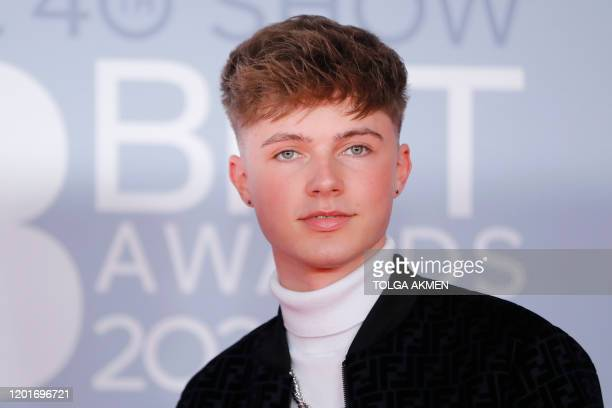 British singer Hrvy poses on the red carpet on arrival for the BRIT Awards 2020 in London on February 18, 2020. / RESTRICTED TO EDITORIAL USE NO...