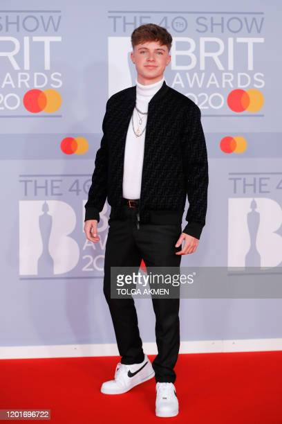 British singer Hrvy poses on the red carpet on arrival for the BRIT Awards 2020 in London on February 18 2020 / RESTRICTED TO EDITORIAL USE NO...