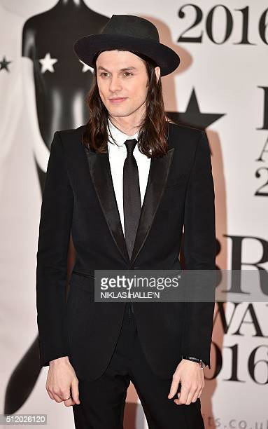 British singer James Bay poses on the red carpet after arriving to attend the BRIT Awards 2016 in London on February 24, 2016. / AFP / NIKLAS HALLE'N...