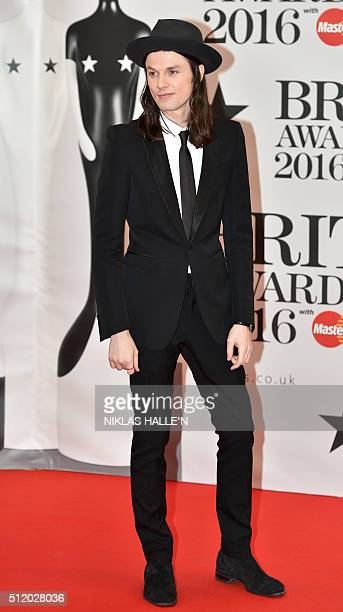 British singer James Bay poses on the red carpet after arriving to attend the BRIT Awards 2016 in London on February 24 2016 / AFP / NIKLAS HALLE'N /...