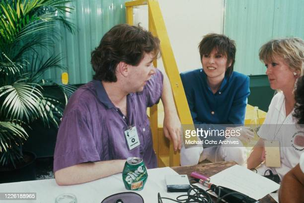 British singer Jim Kerr, lead singer of Simple Minds, with his wife, American singer-songwriter Chrissie Hynde, during preparations for the Live Aid...