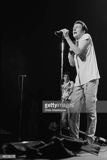 British singer Joe Strummer and guitarist Mick Jones of punk band The Clash on stage at the Rainbow Theatre, London during their 'White Riot' tour,...