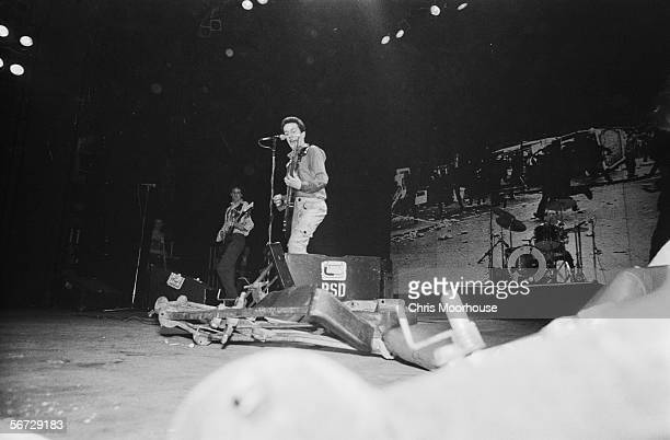 British singer Joe Strummer with guitarist Mick Jones and drummer Topper Headon of punk band The Clash on stage at the Rainbow Theatre, London during...