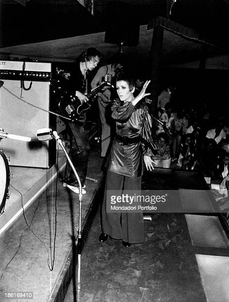 British singer Julie Driscoll performing accompanied by a bass player in the club La Bussola Le Focette 1968