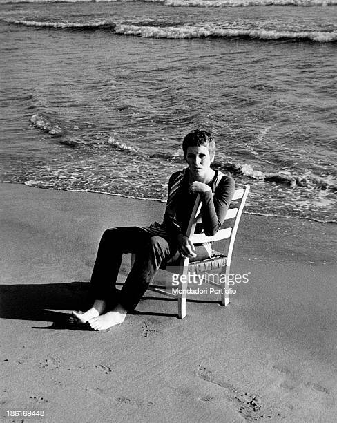 British singer Julie Driscoll sitting on a chair by the seashore 1960s