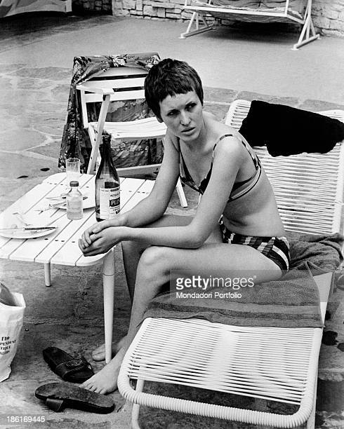 British singer Julie Driscoll wearing a bikini sitting on a deckchair 1968