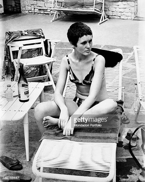 British singer Julie Driscoll wearing a bikini swimsuit sitting on a deckchair 1968