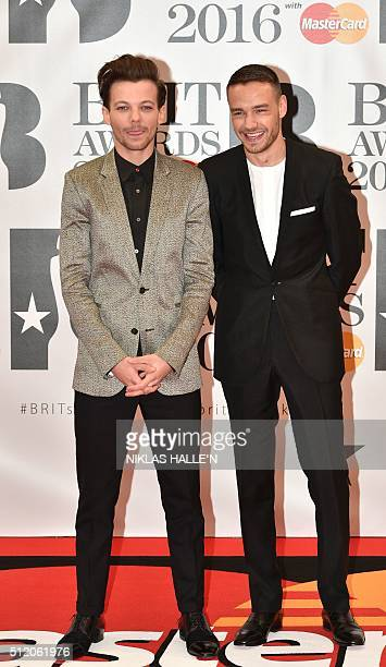 British singer Laim Payne and British singer Louis Tomlinson from the British band One Direction pose on the red carpet after arriving to attend the...