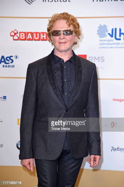 British singer Mick Hucknall of the band Simply Red attends the Deutscher Radiopreis at Elbphilharmonie on September 25 2019 in Hamburg Germany
