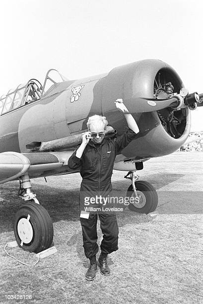 British singer musician and pilot Gary Numan stands in front of a vintage airplane on August 26 1984