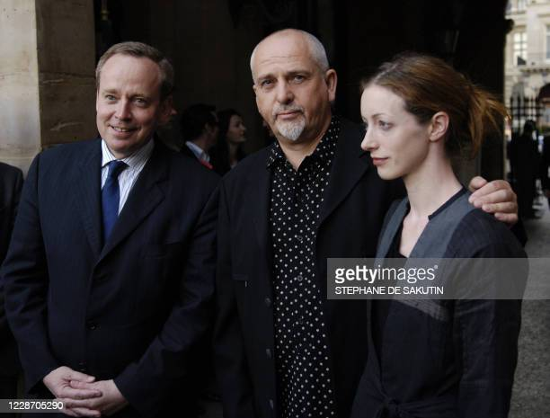 British singer Peter Gabriel poses with his friend next to French Culture minister Renaud Donnedieu de Vabres at the Palais Royal after the Meetings...