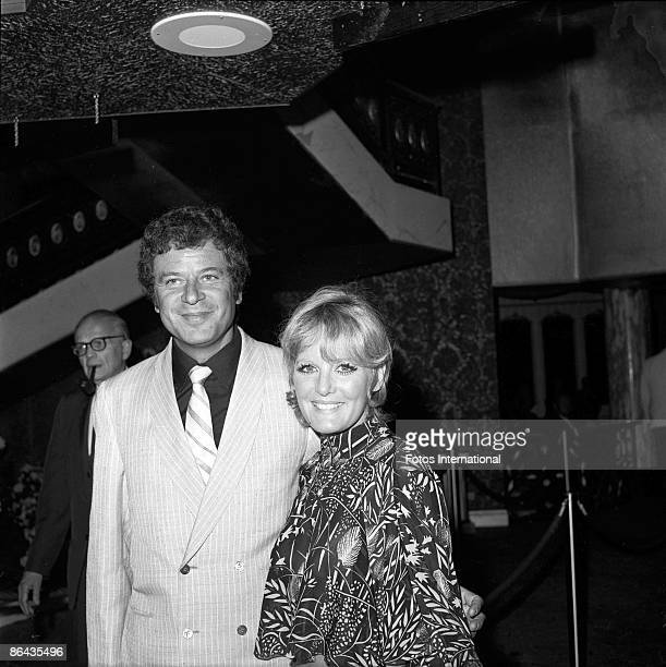British singer Petula Clark and her husband, French music agent Claude Wolff pose together in the lobby of the International Hotel at the opening of...