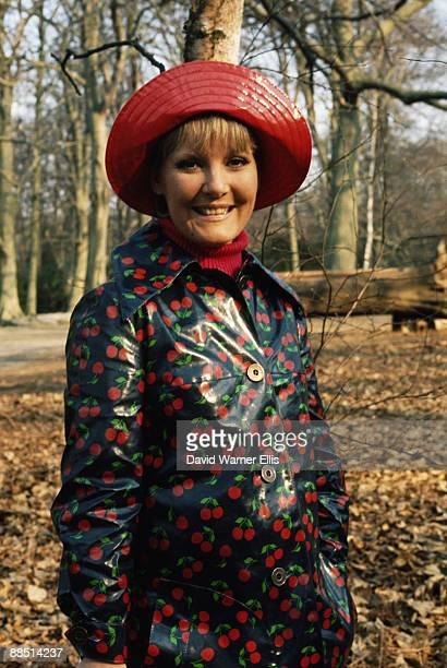 British singer Petula Clark poses in a raincoat in London early 1970's