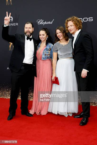 British singer Rea Garvey, his wife Josephine Garvey and German singer Michael Schulte and his wife Katharina Mayer arrive for the 71st Bambi Awards...