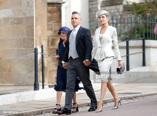 British singer Robbie Williams arrives with his wife Ayda Fields right and his motherinlaw Gwen Fields for the wedding of Princess Eugenie of York...