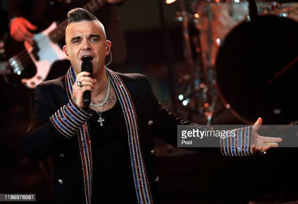 British singer Robbie Williams performs onstage during the Ein Herz Fuer Kinder Gala show at Studio Berlin Adlershof on December 7, 2019 in Berlin,...
