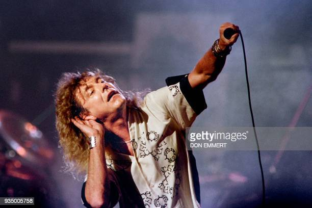 British singer Robert Plant listens to the audience reaction during a Led Zeppelin reunion performance at Madison Square Garden in NewYork on May 14...