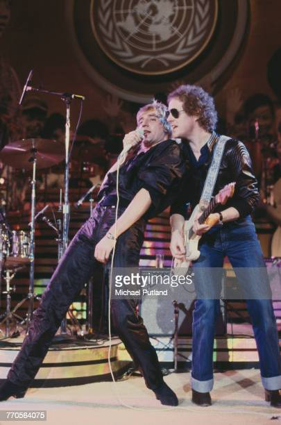 British singer Rod Stewart performing with guitarist Jim Cregan at 'The Music for UNICEF Concert A Gift of Song' benefit concert held at the United...