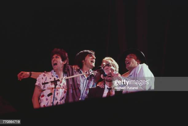 British singer Rod Stewart performs live on stage with from left Ian McLagan Ronnie Wood Kenney Jones and Ronnie Lane at a Faces reunion during the...