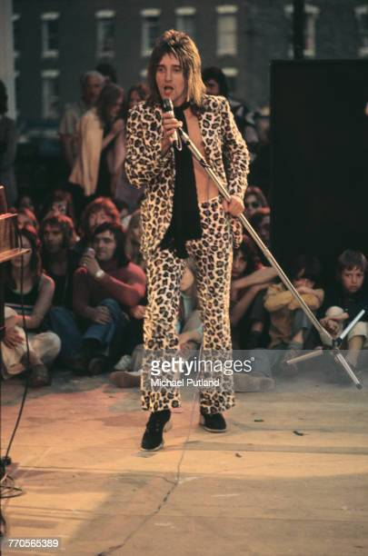 British singer Rod Stewart wearing leopard print jacket and trousers performs live on stage with the Faces during Rock At The Oval in London 18th...