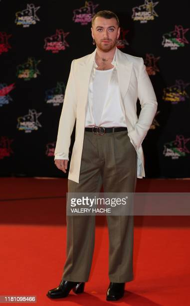 British singer Sam Smith poses on the red carpet as he arrives to attend the 21st NRJ Music Awards ceremony at the Palais des Festivals in Cannes,...