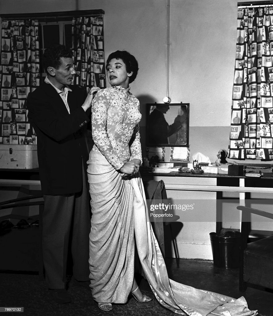 1957. British singer, Shirley Bassey with her manager, Michael ...
