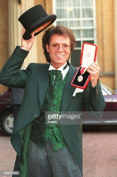 British Singer Sir Cliff Richard Seen outside Buckingham Palace after receiving his Knighthood