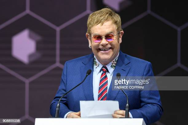 British singer Sir Elton John delivers a speech after receiving a Crystal Award from the hands of Schwab Foundation for Social Entrepreneurship...
