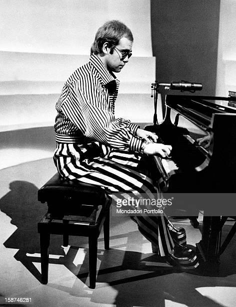 British singer, songwriter and musician Elton John playing piano. Rome, 1973