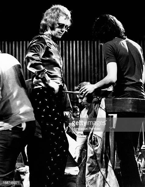 British singer, songwriter and musician Elton John with some members of his band during the rehearsal. Rome, 1974