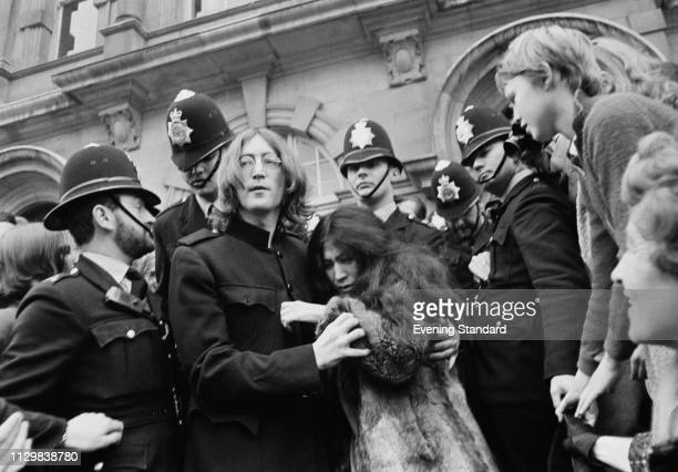 British singer, songwriter and musician John Lennon and his girlfriend Yoko Ono leave Marylebone Magistrates' Court in London, after their hearing on...