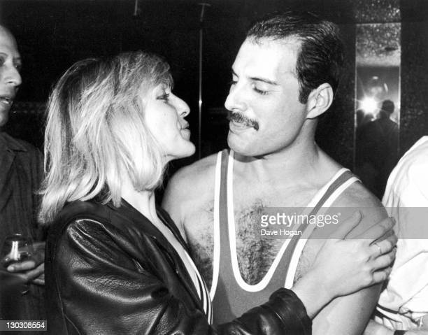 British singer songwriter and record producer Freddie Mercury of British rock band Queen with his friend Mary Austin during Mercury's 38th birthday...