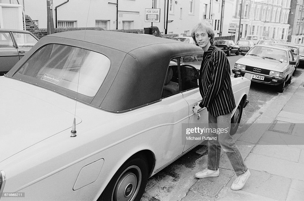 British singer, songwriter, musician and producer Robin Gibb (1949 - 2012) of the Bee Gees, with his Rolls-Royce Corniche, UK, 1984.