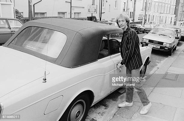 British singer songwriter musician and producer Robin Gibb of the Bee Gees with his RollsRoyce Corniche UK 1984