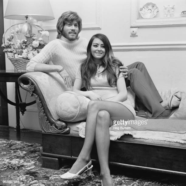 British singer, songwriter, musician and record producer Barry Gibb with his girlfriend Linda Gray, UK, 8th June 1970.