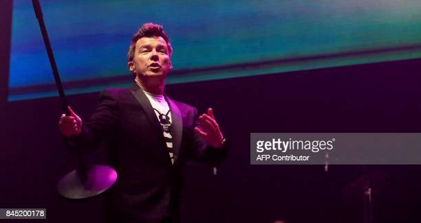 British singer songwriter Rick Astley performs during the 'We Are Manchester' charity concert at the Manchester Arena in Manchester northwest England...
