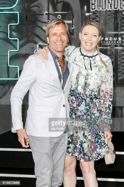 British singer Steve Norman and his wife Sabrina Winter attend the 'Atomic Blonde' World Premiere at Stage Theater on July 17 2017 in Berlin Germany