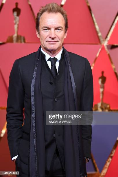 British singer Sting poses as he arrives on the red carpet for the 89th Oscars on February 26 2017 in Hollywood California / AFP / ANGELA WEISS