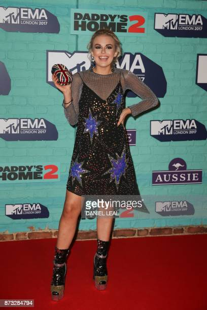 British singer Tallia Storm poses on the red carpet arriving to attend the 2017 MTV Europe Music Awards at Wembley Arena in London on November 12...