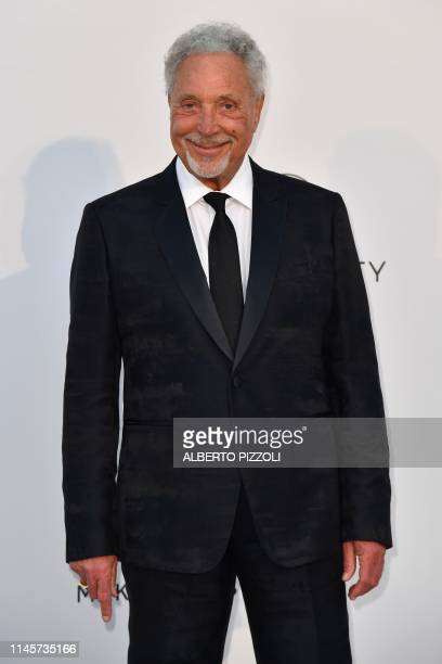 British singer Tom Jones poses as he arrives on May 23 2019 for the amfAR 26th Annual Cinema Against AIDS gala at the Hotel du CapEdenRoc in Cap...