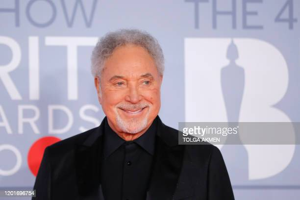 British singer Tom Jones poses on the red carpet on arrival for the BRIT Awards 2020 in London on February 18, 2020. / RESTRICTED TO EDITORIAL USE NO...