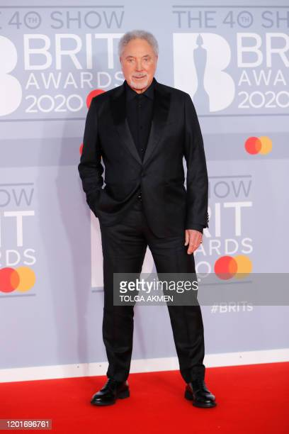 British singer Tom Jones poses on the red carpet on arrival for the BRIT Awards 2020 in London on February 18, 2020. - RESTRICTED TO EDITORIAL USE NO...