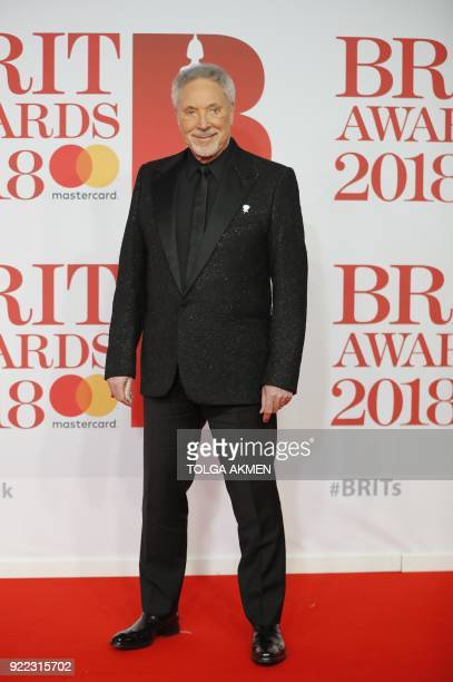 British singer Tom Jones poses on the red carpet on arrival for the BRIT Awards 2018 in London on February 21 2018 / AFP PHOTO / Tolga AKMEN /...