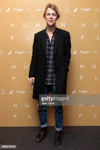 British singer Tom Odell poses as he arrives for the Human Flow premiere at Milton Court Concert Hall on December 4 2017 in London England