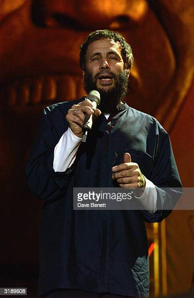 British singer Yusuf Islam performs on stage as part of the Give 1 Minute to AIDS concert for The Nelson Mandela Foundation's 46664 campaign held at...